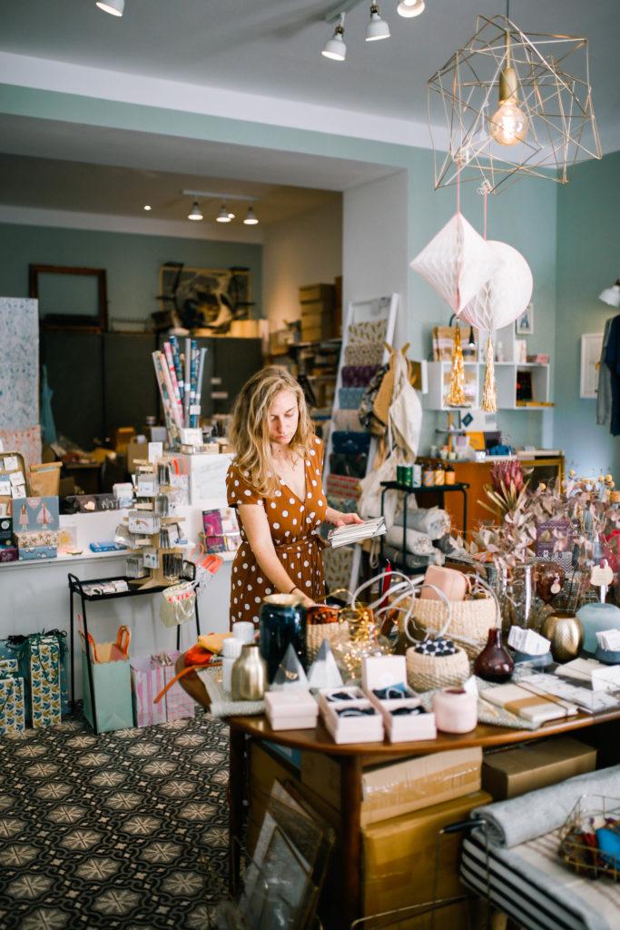 A shop owner sorts her assortment.