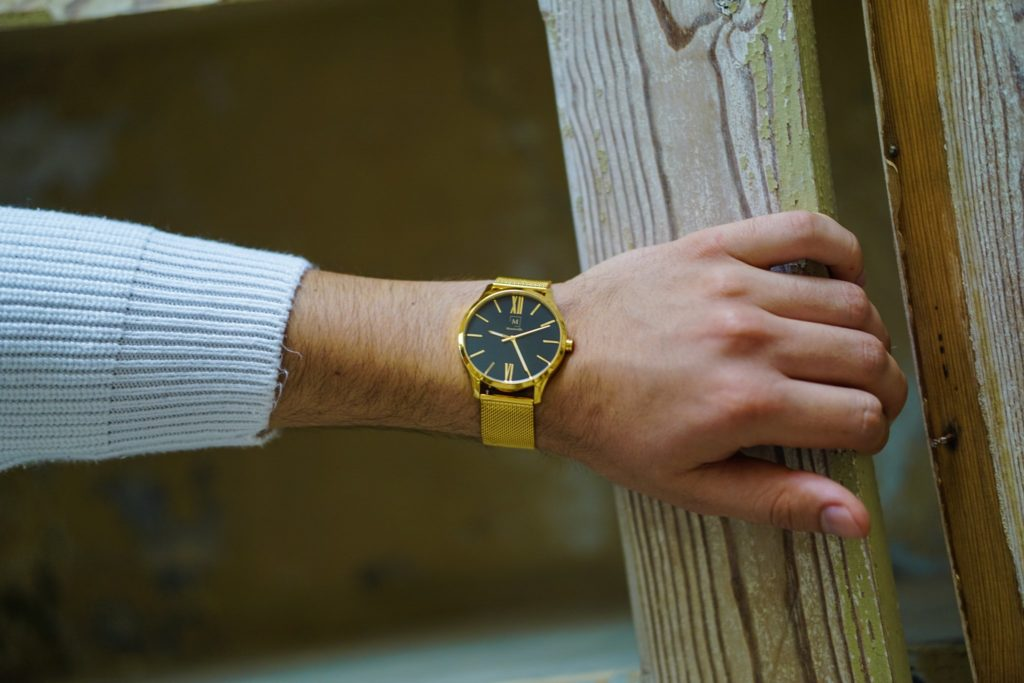 a golden watch on a man's wrist