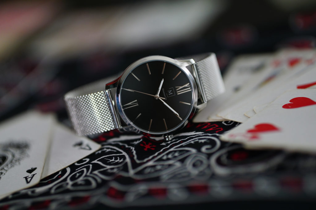 a watch laying on a set of cards