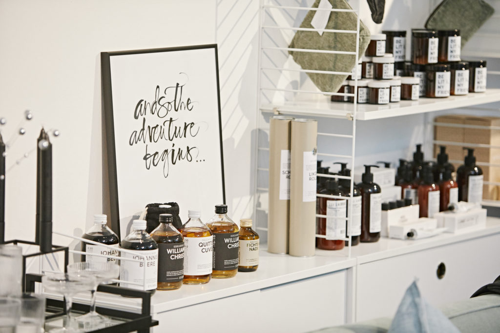Soaps, lotion and other beauty products on a shelf in a store