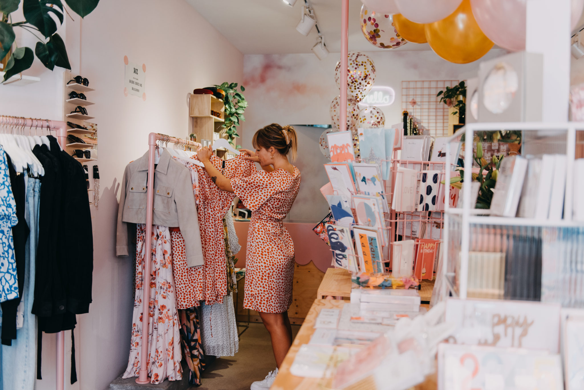 Female shop owner in her small concept store